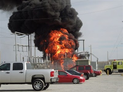 fire in facility seen from parking lot