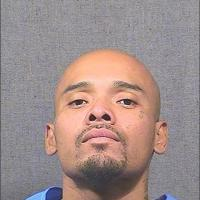 """Daniel Perez, Hispanic male (medium/light brown complexion), 5'10"""", 187 pounds, with a shaved head and brown eyes"""