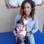 Inmate Christa Ann Ramirez holding an infant