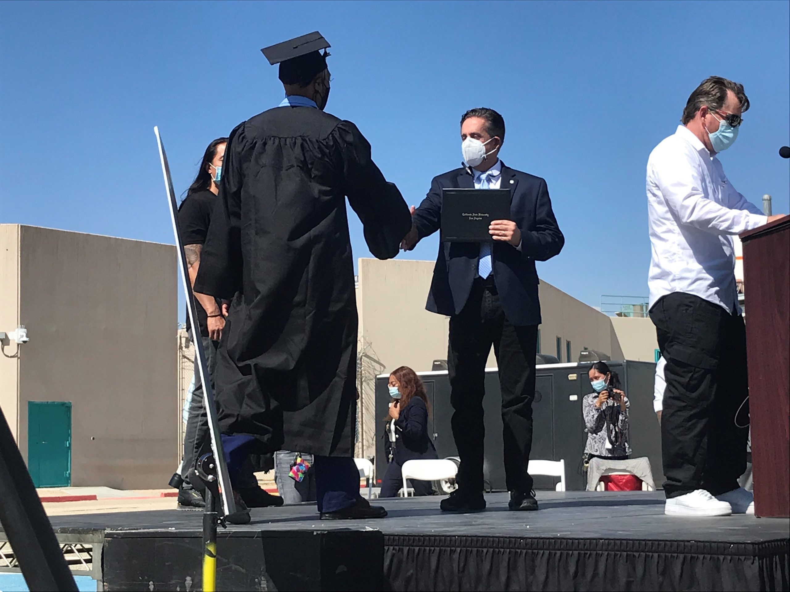 image of graduate receiving a certificate