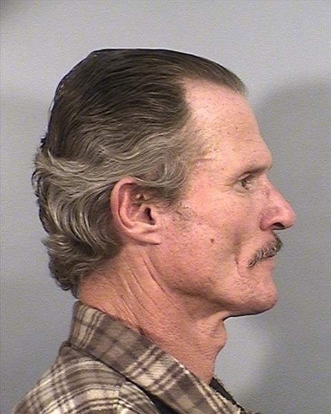Side mugshot image of Earl Eugene Linker
