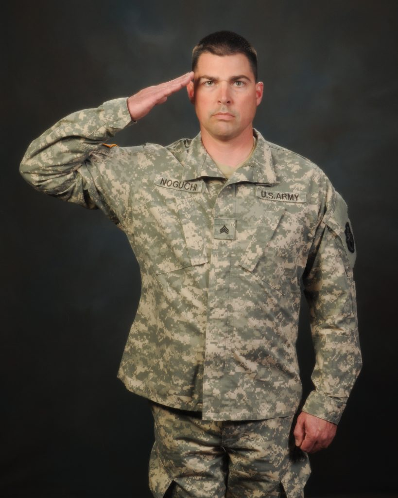 CDCR Officer in military uniform, in salute stance.