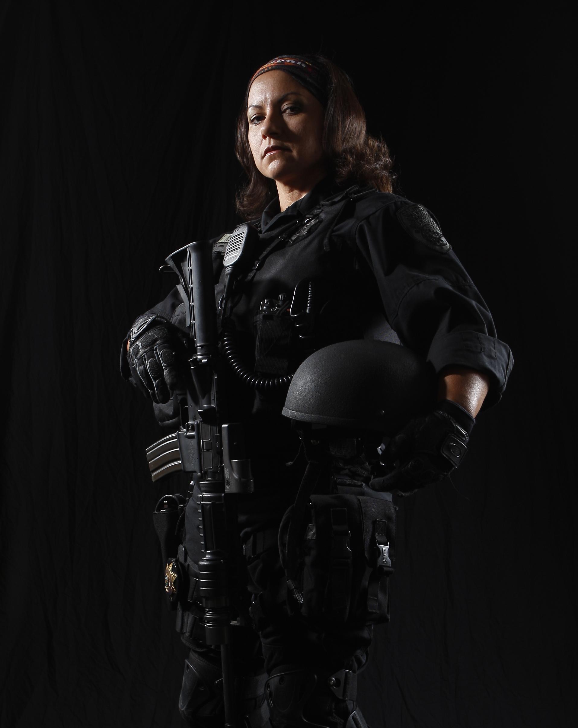 Agent Karen Mory in tactical gear uniform