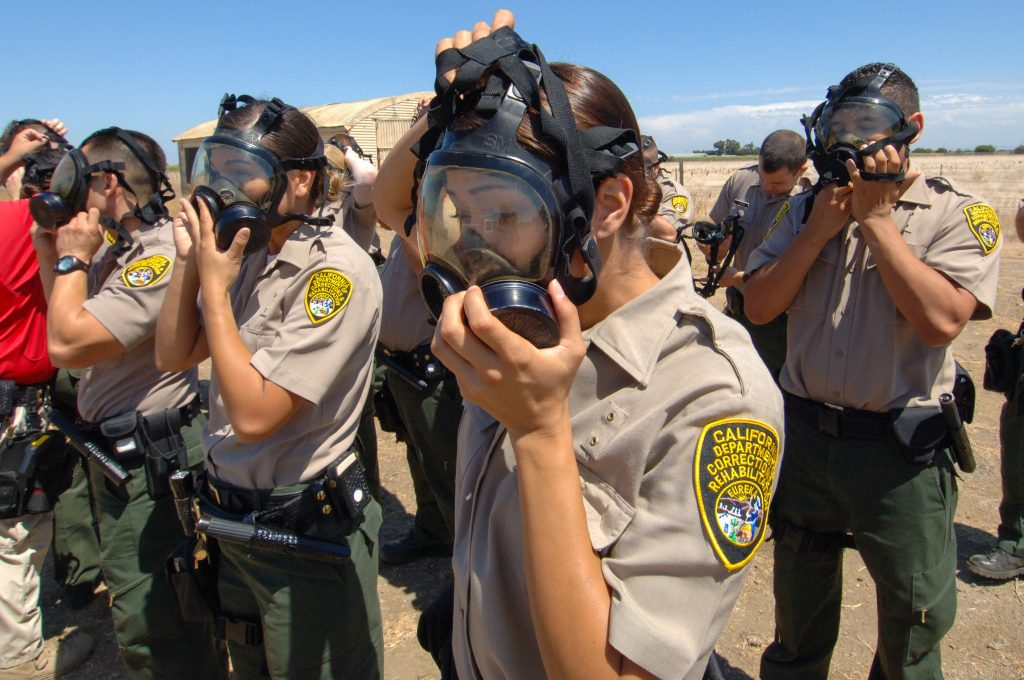 peace officer candidates putting on gas masks