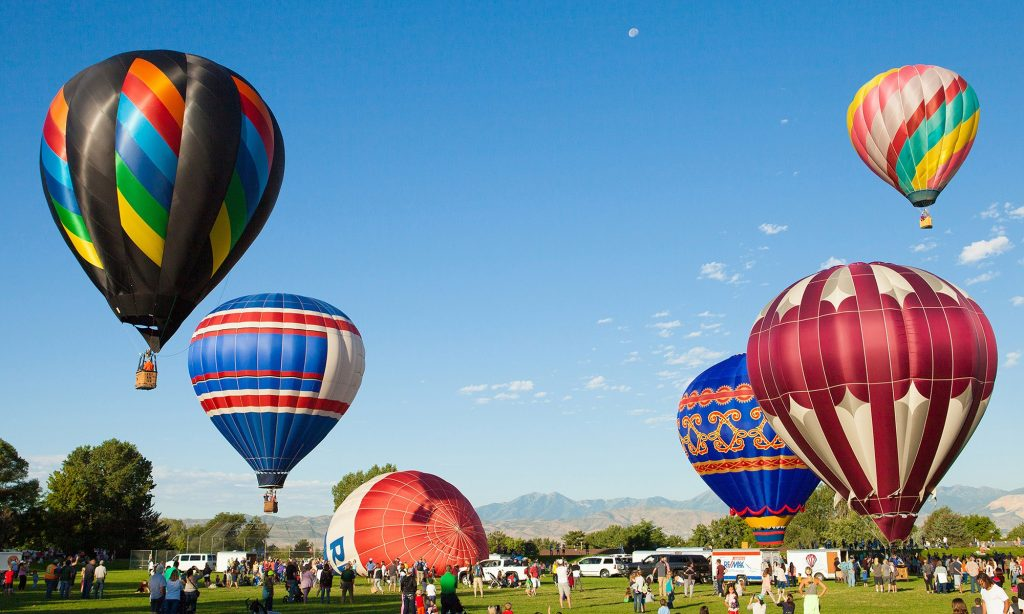 hot  air balloons launching from the ground