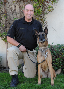 Peace Officer Cortez and Mattie the dog