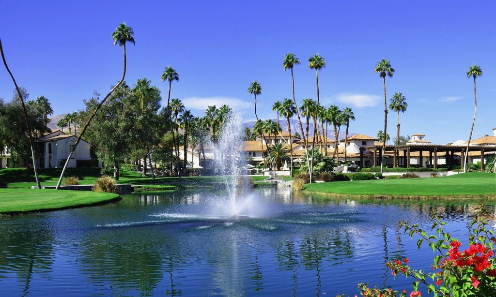 Palm Springs with waterfall in the middle of lake