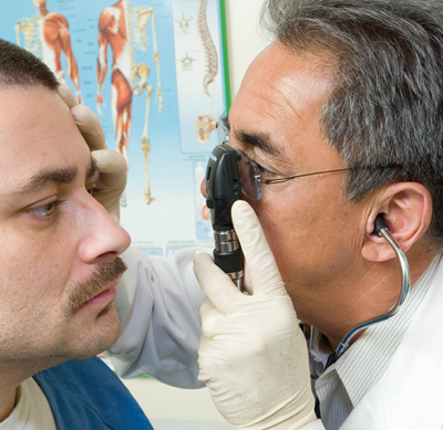 doctor checking on patient's eyes
